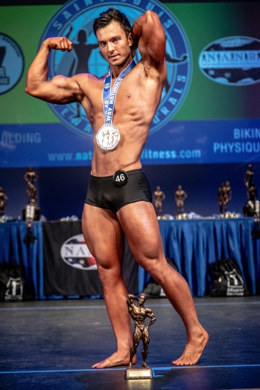 Here I am winning my novice class in the classic physique category (2018).
